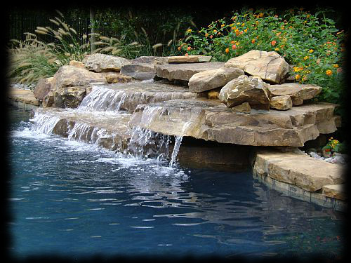 Swimming pool water features custom designed aquatic for Pool design water feature